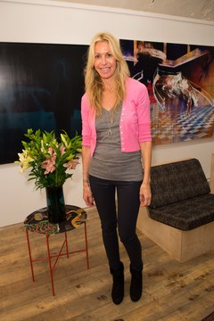 European designer Melissa Odabash tops a gray tank top with a bright pink cardigan.