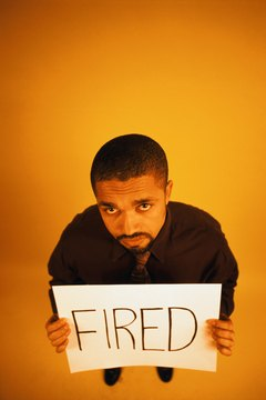 Businessman holding fired sign board, portrait