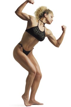 Perfecting the required poses is an important part of training for bodybuilding competitions.