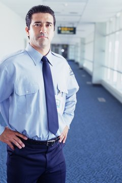 airport security guard standing with hands on hips portrait