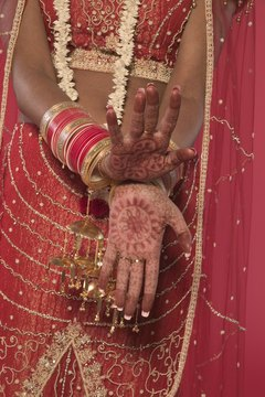 Muslim brides in the Asian subcontinent often have henna tattoos painted on their hands and feet for the wedding ceremony.