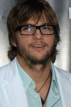 Actor Ashton Kutcher channels his inner geek with a pair of funky horn-rimmed glasses.