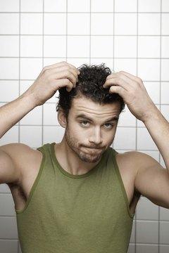 Man fixing his hair