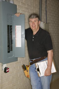 Man checking fuse box