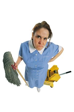 Woman janitor with cigarette holding a mop