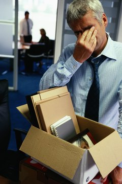 Man packing up office belongings