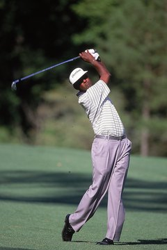 Vijay Singh plays a shot at the 2000 Masters, which he won by three strokes.