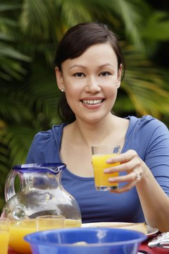 Taking vitamins with fresh orange juice is fine.