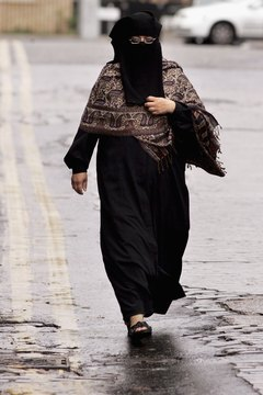 Some women wear a niqab, a black full-body cover that hides the face.