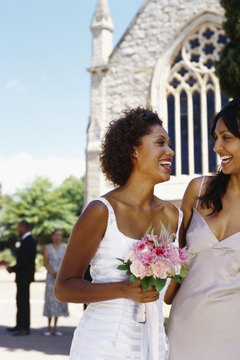 Bride and bridesmaid standing outside church