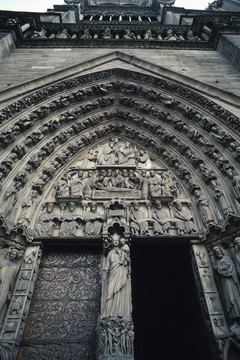 Detailed sculpture decorates the entrance to the Gothic cathedral Notre Dame.