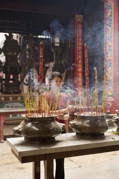 Buddhist incense is burnt to purify the area around the deceased.