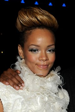 Rihanna's long mohawk allows for wavy styling that creates a feminine look.