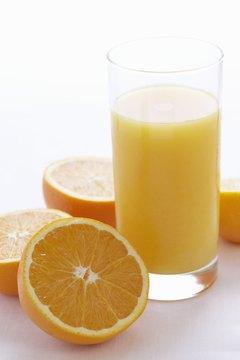 Orange juice with pulp is higher in fiber.