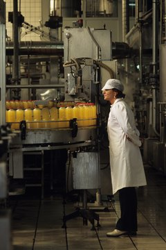 Inspector checking production line in bottling plant