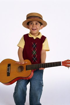 Let your toddler strum a guitar to motivate him to sing along.