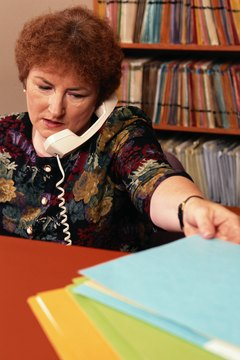 A physical therapy aide often performs secretarial tasks.