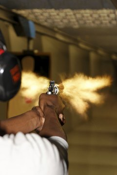 Man Firing Revolver Gun with Muzzle Flash