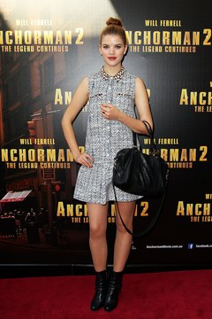 "Singer Emma Birdsall wears a gray dress with black ankle boots at the ""Anchorman 2"" premiere in Sydney in 2013."