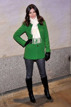 Actress Victoria Justice rocks dressy black boots over skinny jeans at New York's Rockefeller Center in 2012.