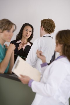 Businesswoman talking to doctor