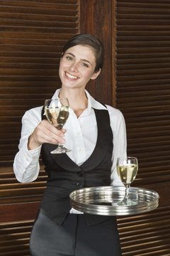 Waitress with glass of wine