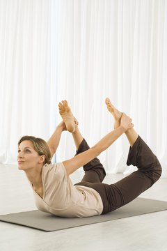 Heat-building poses such as Bow pose can tone your body and help burn fat.