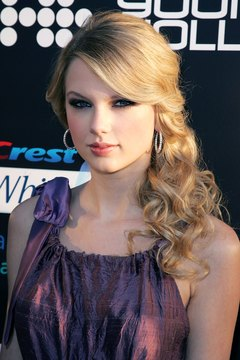 The side ponytail looks best with bangs swept to the same side as the pony as seen on Taylor Swift.