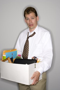 Businessman holding box of belongings