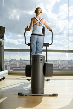 Challenge your thighs by climbing on an elliptical machine for 30 minutes or more.