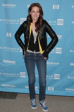 A leather jacket and tennis shoes give Kristen Stewart instant tomboy style.