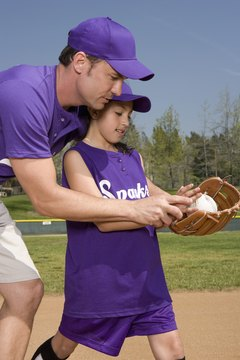 Coach teaching little league player