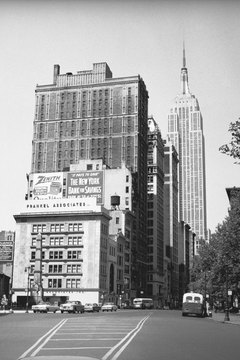 The Empire State Building, which was completed in 1931, looms in the background.