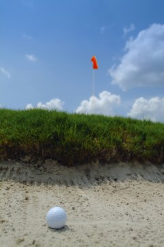 Many golfers' worst nightmare -- a ball in a sand trap.