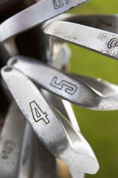 Each iron has a different loft, shorter shafted clubs have greater lofts and vice versa.