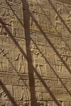 Egyptians carved both hieroglyphics and symbols into walls in places of power, like palaces and tombs.