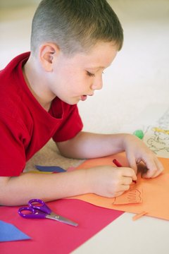Fine-motor skills enable a child to cut and color successfully.
