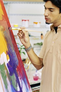 The fine art student spends many hours at his or her canvas working.