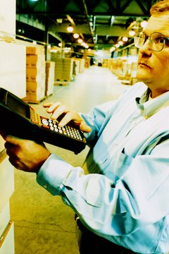 Man Taking Inventory in a Warehouse