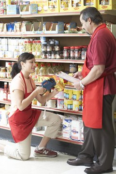Side profile of a salesman talking to a saleswoman in a grocery store