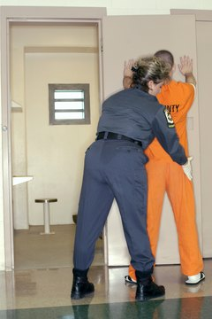 Corrections officers perform pat-downs to check for contraband.