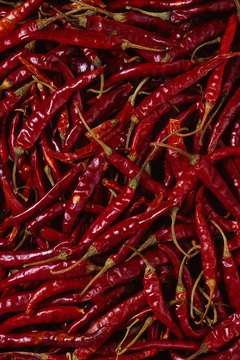 Cayenne pepper is the most common name for these long, thin, red peppers.