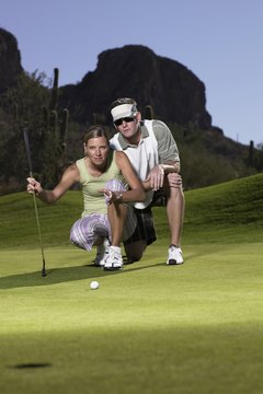 Caddies help golfers read putts.