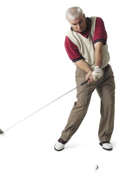 Golfers must swing down to lift the ball into the air properly.