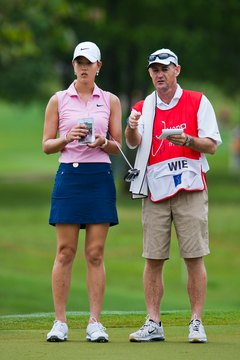 Professional golfers and caddies use detailed yardage books.