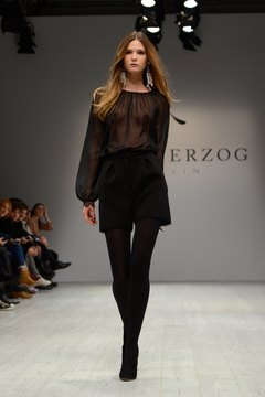 A model struts in high-waisted shorts and tights during fashion week in Berlin, Germany.