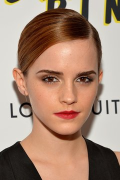 Emma Watson sports natural-looking highlights at a film screening at the Paris Theatre in New York.