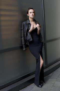 British journalist Lucy Watson pairs an elegant black strapless dress with a studded leather jacket for an edgy look.