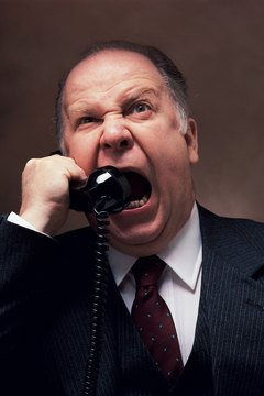 Irate businessman yelling into telephone