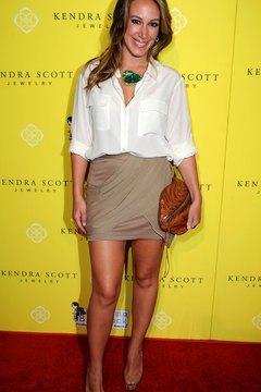 Haylie Duff pairs a jersey miniskirt with an oversized blouse and nude heels.